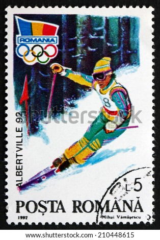 ROMANIA - CIRCA 1992: a stamp printed in the Romania shows Alpine Skiing, 1992 Winter Olympic Games, Albertville, circa 1992 - stock photo