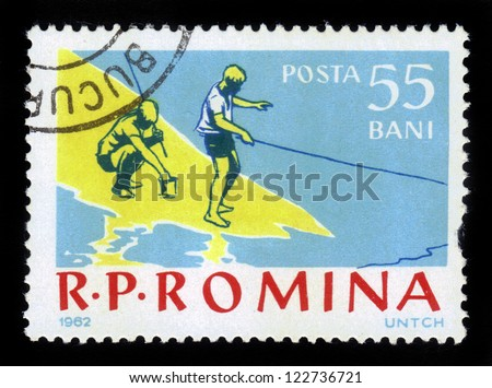 ROMANIA - CIRCA 1962: A stamp printed in the Romania shows boys on a fishing trip, circa 1962. - stock photo
