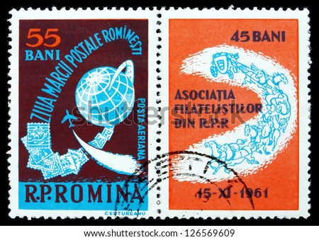 ROMANIA - CIRCA 1961: a stamp printed in the Romania shows Globe and Stamps, Stamp Day, circa 1961