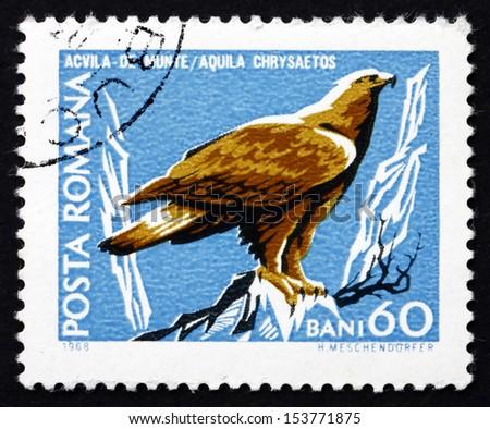 ROMANIA - CIRCA 1968: a stamp printed in the Romania shows Golden Eagle, Aquila Chrysaetos, Bird of Prey, circa 1968 - stock photo