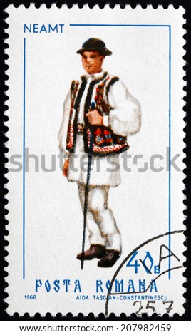 ROMANIA - CIRCA 1968: a stamp printed in the Romania shows Man from Neamt, Traditional Regional Costume, circa 1968 - stock photo