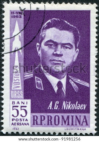ROMANIA - CIRCA 1962: A stamp printed in the Romania, shows Soviet cosmonaut Andriyan Nikolayev and the silhouette of space rocket Vostok 3, circa 1962