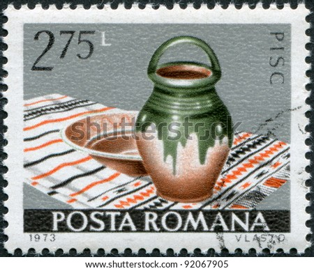 ROMANIA - CIRCA 1973: A stamp printed in the Romania, shows the Bowl and jug, Pisc, circa 1973 - stock photo