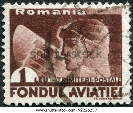 ROMANIA - CIRCA 1936: A stamp printed in the Romania, shows the head of the pilot and the wing of an eagle, circa 1936 - stock photo