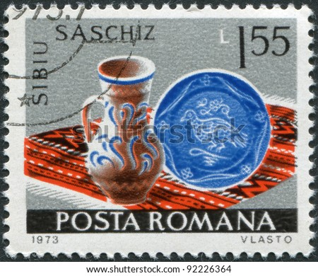 ROMANIA - CIRCA 1973: A stamp printed in the Romania, shows the Pitcher and plate, Sibiu-Saschiz, circa 1973 - stock photo