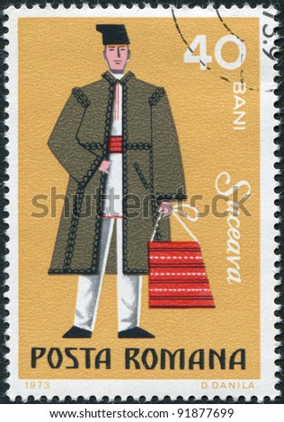 ROMANIA - CIRCA 1973: A stamp printed in the Romania, shows the traditional dress of men in the region Suceava, circa 1973 - stock photo