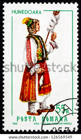 ROMANIA - CIRCA 1968: a stamp printed in the Romania shows Woman from Hunedoara, Traditional Regional Costume, circa 1968 - stock photo