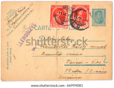 ROMANIA - CIRCA 1940: An old used Romanian postcard and postage stamps from World War II, showing portraits of the King of Romania, was printed in Romania, series, circa 1940 - stock photo
