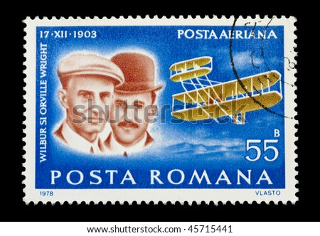 ROMANIA - CIRCA 1978: Mail stamp printed in Romania showing the Wright Brothers historic first powered aircraft flight, circa 1978 - stock photo