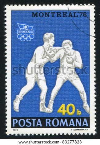 ROMANIA - CIRCA 1976: stamp printed by Romania, show boxing, circa 1976. - stock photo