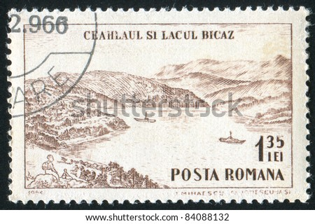 ROMANIA - CIRCA 1964: stamp printed by Romania, shows Ceahlaul peak and Lake Bicaz, circa 1964