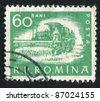 ROMANIA - CIRCA 1960: stamp printed by Romania, shows Harvester, circa 1960 - stock photo