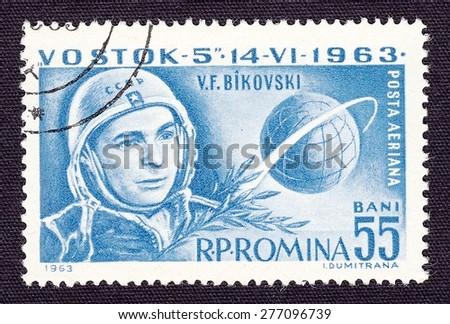 ROMANIA - CIRCA 1965: stamp printed by Romania, shows Valery Bykovsky - pilot-cosmonaut of the USSR, circa 1965 - stock photo