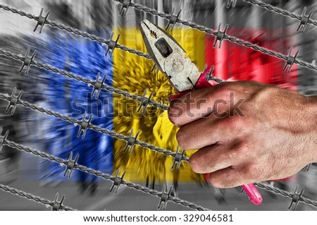 Romania flag, migrants, barb wire with pliers