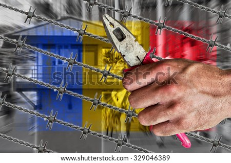 Romania flag, migrants, border house and barb wire with pliers