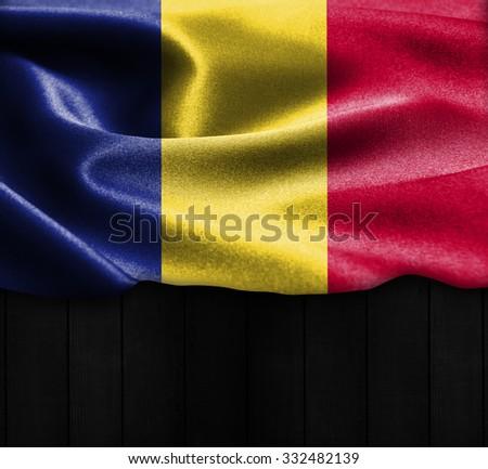 Romania flag on wood Texture - stock photo