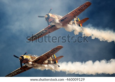 ROMANIA - JULY 23 Two unidentified vintage monoplane aircraft flying in formation at an air show on July 23, 2016 in Campia Turzii, Romania