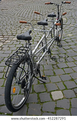 ROMANIA, TIMISOARA - September 21, 2013: Bicycle with three seats exposed at one bicycle exhibition.