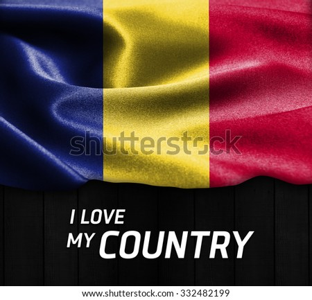 Romania waving flag with Text I Love My Country on wood texture background - stock photo