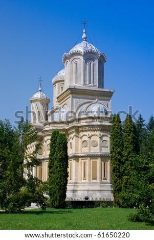 Romanian Cristian Church in green garden - stock photo
