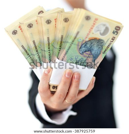 Romanian currency stacks in woman hand - closeup, shallow depth, isolated