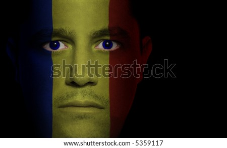 Romanian flag painted/projected onto a man's face.