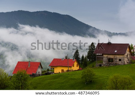 Romanian mountain village houses placed on a hill