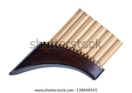 Romanian pan flute on white background - stock photo