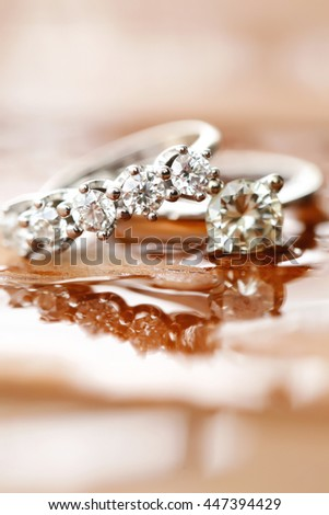 Romantic and lovely wedding rings shooting inside water - stock photo