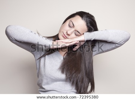 Romantic and peaceful young woman with closed eyes