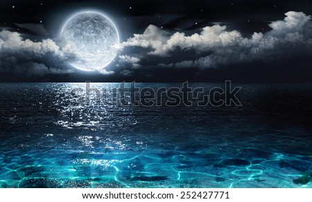 romantic and scenic panorama with full moon on sea to night  - stock photo