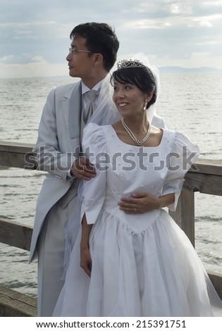 Romantic Asian Newlyweds - stock photo
