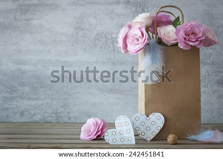 Romantic background with roses and handmade hearts - copy space - stock photo