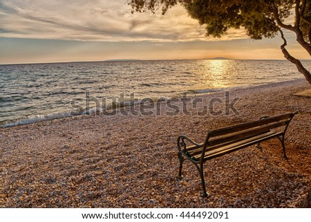 Romantic Beach Bench at Sunset at Adriatic Sea in Artistic Light