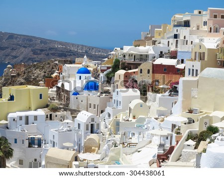 Romantic beautiful cityscape and blue sky of Oia on Santorini island in Greece. - stock photo