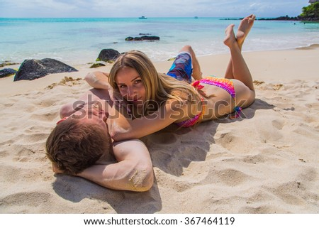 Romantic beautiful couple lying on the beach on the beautiful island of Mauritius - stock photo