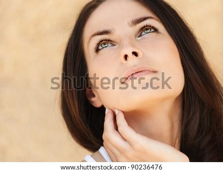 romantic beautiful long dark hair woman looking up - stock photo
