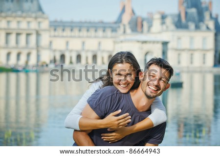 Romantic Beautiful young couple walking in Fontainebleau