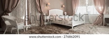 Romantic beauty bedroom interior with soft carpet, panorama - stock photo