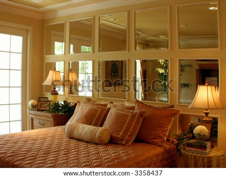 romantic bedroom mirrors decorating the wall - stock photo