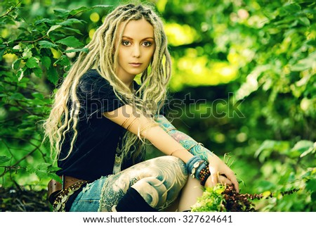 Romantic boho style girl in the wild wood. Boho, hippie fashion shot. - stock photo