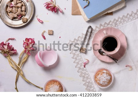 Romantic breakfast, fresh coffee, cupcake desserts and pink flowers served with love. Top view.  - stock photo