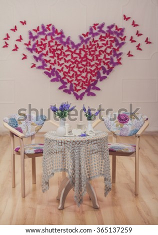 Romantic cafe for couple with butterflies on background - stock photo