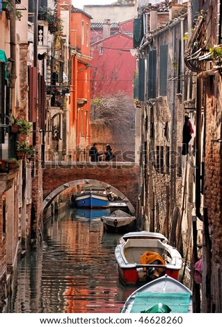 Romantic canal in center of Venice. - stock photo