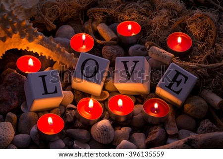 Romantic candels on the beach - stock photo