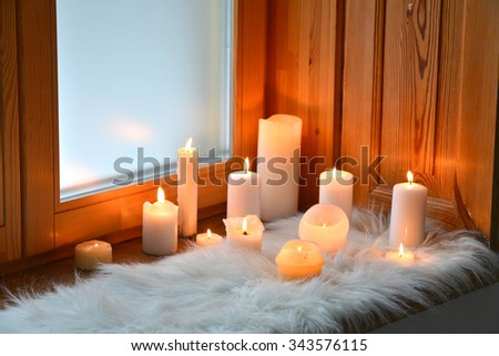 Romantic candles on window sill - stock photo