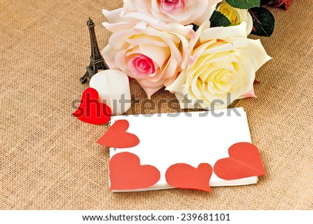 romantic card for Valentine's Day with roses. hearts and white notebook with space for text
