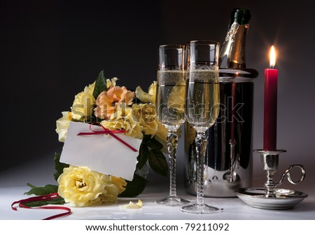 Romantic card with burning candles and champagne