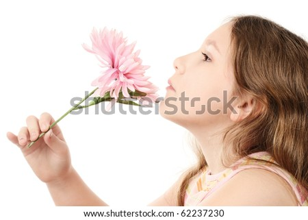 Romantic child girl's profile with pink flower in the hand isolated on white background