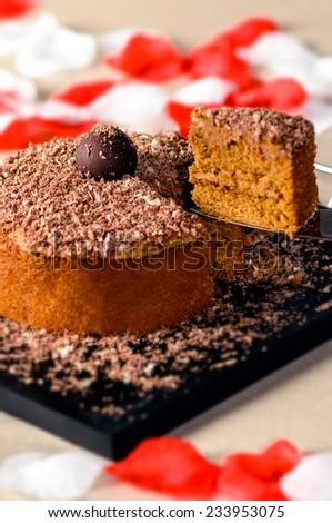 Romantic chocolate walnut cake with slice up - stock photo